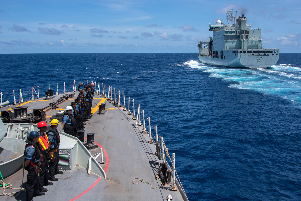 HMCS Regina and NRU Asterix conduct a Replenishment at Sea during Operation Projection in the Indian Ocean. Photo by Cpl Stuart Evans, BORDEN Imaging Services