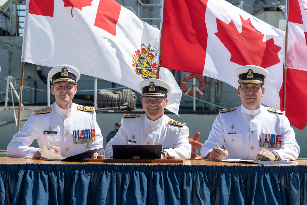 From left, outgoing Commander Canadian Fleet Atlantic, Cmdre Skjerpen; RAdm Craig Baines, Commander Maritime Forces Atlantic, with incoming Commander Cmdre Richard Feltham at the Change of Command ceremony July 11. Photo by Cpl David Veldman, FIS