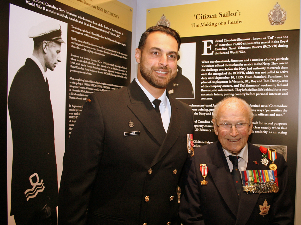 Base Commander, Capt(N) Sam Sader and Cdr (Retired) Peter Chance chat during an unveiling ceremony for the war medals of Cdr Ted Simmons at the CFB Esquimalt Naval and Military Museum on July 10. Photo by Peter Mallett, Lookout
