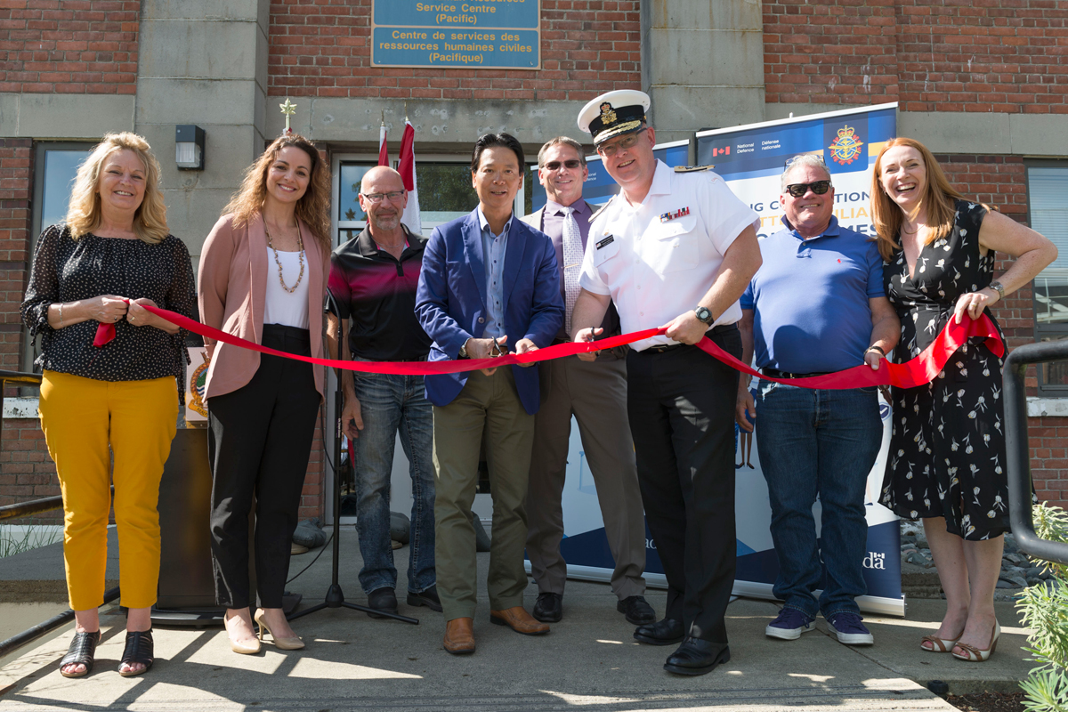 Rear-Admiral Bob Auchterlonie and Kin Choi, Assistant Deputy Minister (HR-CIV) cut the ribbon during the ceremony on June 26. Photo by Leading Seaman Sisi Xu, MARPAC Imaging Services