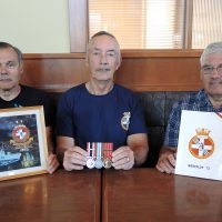 From left: Lt(N) (Retired) André Robin, CPO2 (Retired) Ken Levert and CPO2 (Retired) Claude Jolivet reminisce about old times back in 1973 when they were aboard HMCS Terra Nova during Canada's peacekeeping mission in the Vietnam conflict. Photo by Peter Mallett, Lookout