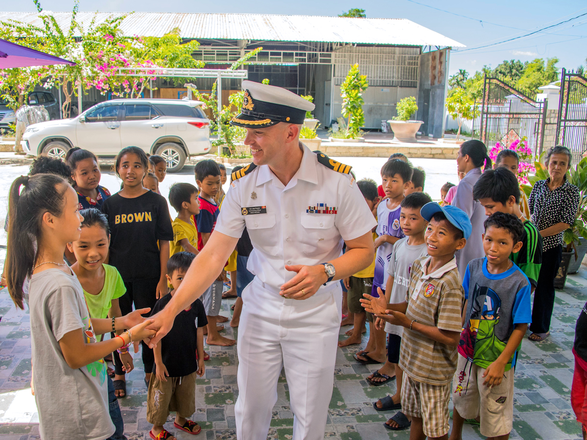 HMCS Regina's Commanding Officer Commander Jacob French joins Deborah Paul, the Ambassador of Canada to Vietnam, with members of the crew for a visit to the Hope Orphanage, Nhan Ai shelter in Khanh Hoa, Vietnam during Operation Projection on June 11. Photo by Corporal Stuart Evans, Borden Imaging Services