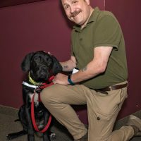 Stephen Holton, Deputy Information Systems Security Officer for the Canadian Army, with his service dog Missie at Canadian Army Headquarters. Photo by Jay Rankin, Directorate of Army Public Affairs