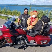 Cpl Alex Millham of CFB Comox poses with Military Police National Motorcycle Relay mascot and social media sensation Ordinary Cadet Moira Stone during this year's ride.