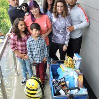 Members of the Pineda and Scott family move groceries into their hotel room in Langford. Photo by Peter Mallett, Lookout Newspaper