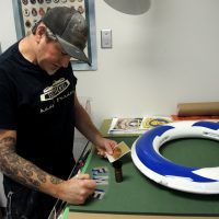 Ryan Yeomans works on a Kisbee ring in his Fleet Maintenance Facility work shop. Photo by Peter Mallett, Lookout