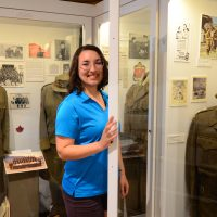 Marina Craig, Vernon Cadet Museum Director of Marketing and Operations, makes a final check on one of the many displays of uniforms before the re-opening of the Vernon Cadet Museum for the summer.