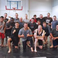 Members of the Naden Grappling Club pose for a group photo during a recent training session at the Naden Athletic Centre.