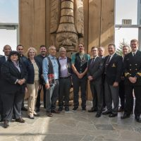 "Canadian Leaders at Sea participants and HMCS Calgary's command team visited the Haida Heritage Centre in Haida Gwaii. From left to right: LCdr Melissa Fudge, CPO1 Todd Jones, Juniors Damy, Candyce Kelshall, Matthew Lewis, Leelah Dawson, Tim Charles, Chief Reg Young (""Gitkun""), Chief Lonnie Young (""Gaahlaay""), Jason Alsop (""Gaagwiis""), Gary Perkins, Derek Threinen, HCol Don Foster, Jeff Topping, Lt(N) Andrew Lauzon, Mark Blevis, and Cdr Jonathan Kouwenberg. Photos by Leading Seaman Shaun Martin, MARPAC Imaging Services"
