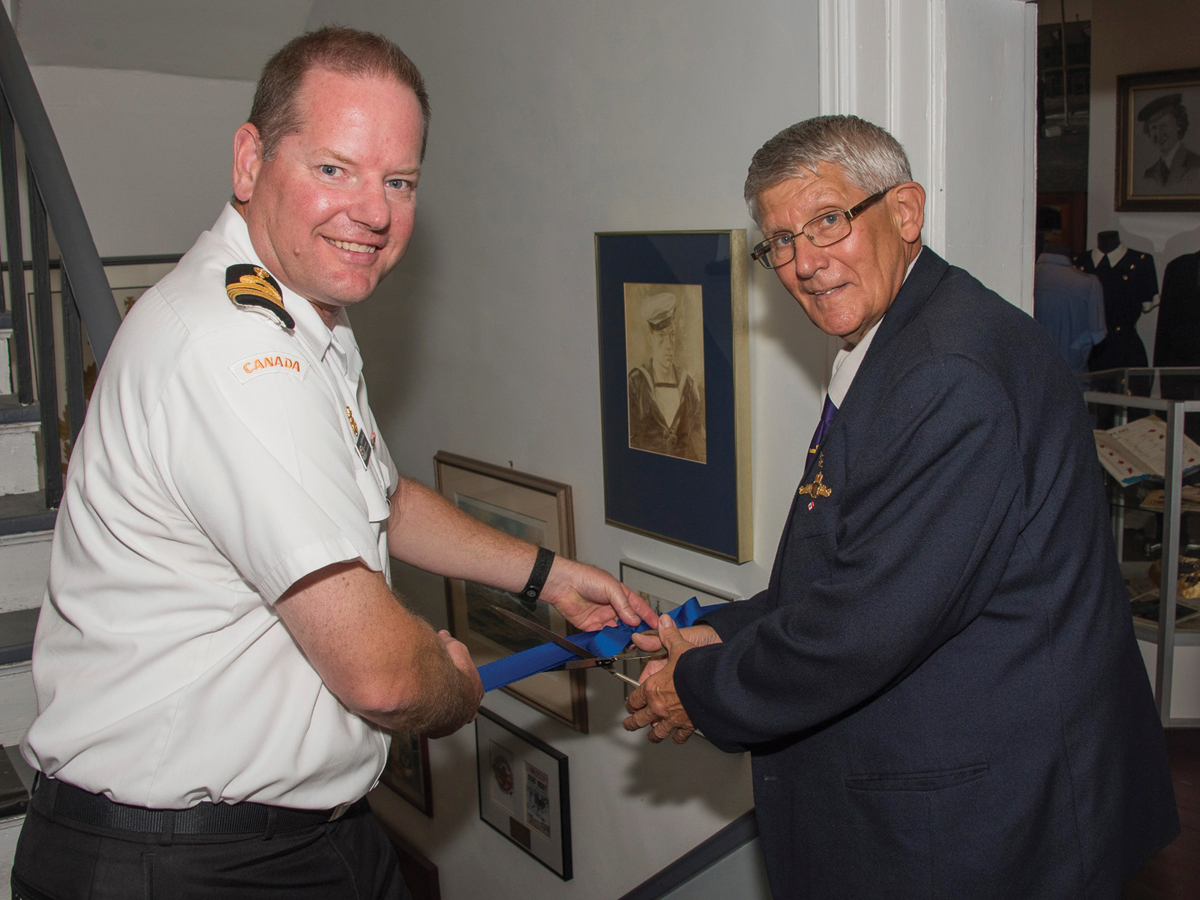 Capt(N) David Mazur, CFB Halifax Base Commander, and CPO2 (Retired) Brian Lapierre, a former submariner, cut the ribbon to officially open the Naval Museum of Halifax's newest exhibit. Photo by Cpl Thompson, Formation Imaging Services