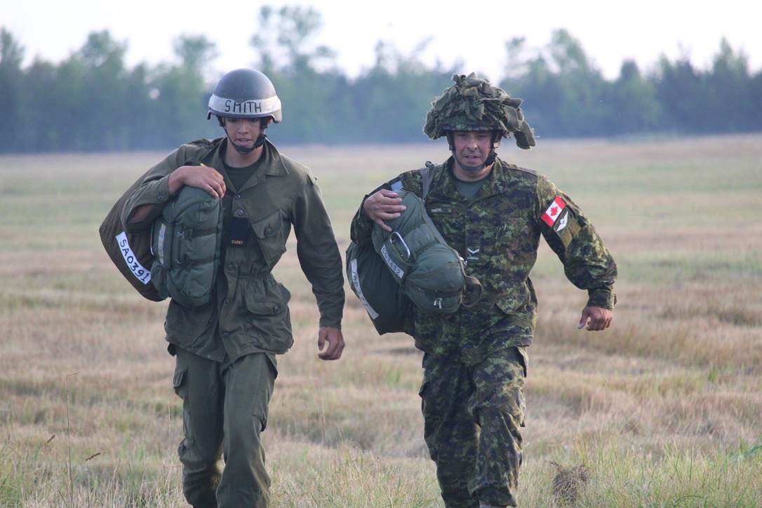 Cadet Warrant Officer Carter Smith of the 2422 Nanaimo Army Cadets walks with his father, RCMP Constable and army reservist Mark Smith, at the drop zone in Trenton, Ont. Photo courtesy Capt Sharon Low