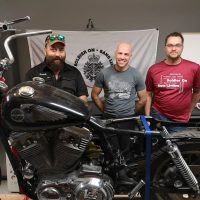 Yanick Létourneau, Christian Jalbert and Érick Cloutier will work as a team to transform a motorbike as a benefit to the Soldier On program. Photo by Édouard Dufour, Adsum Newspaper