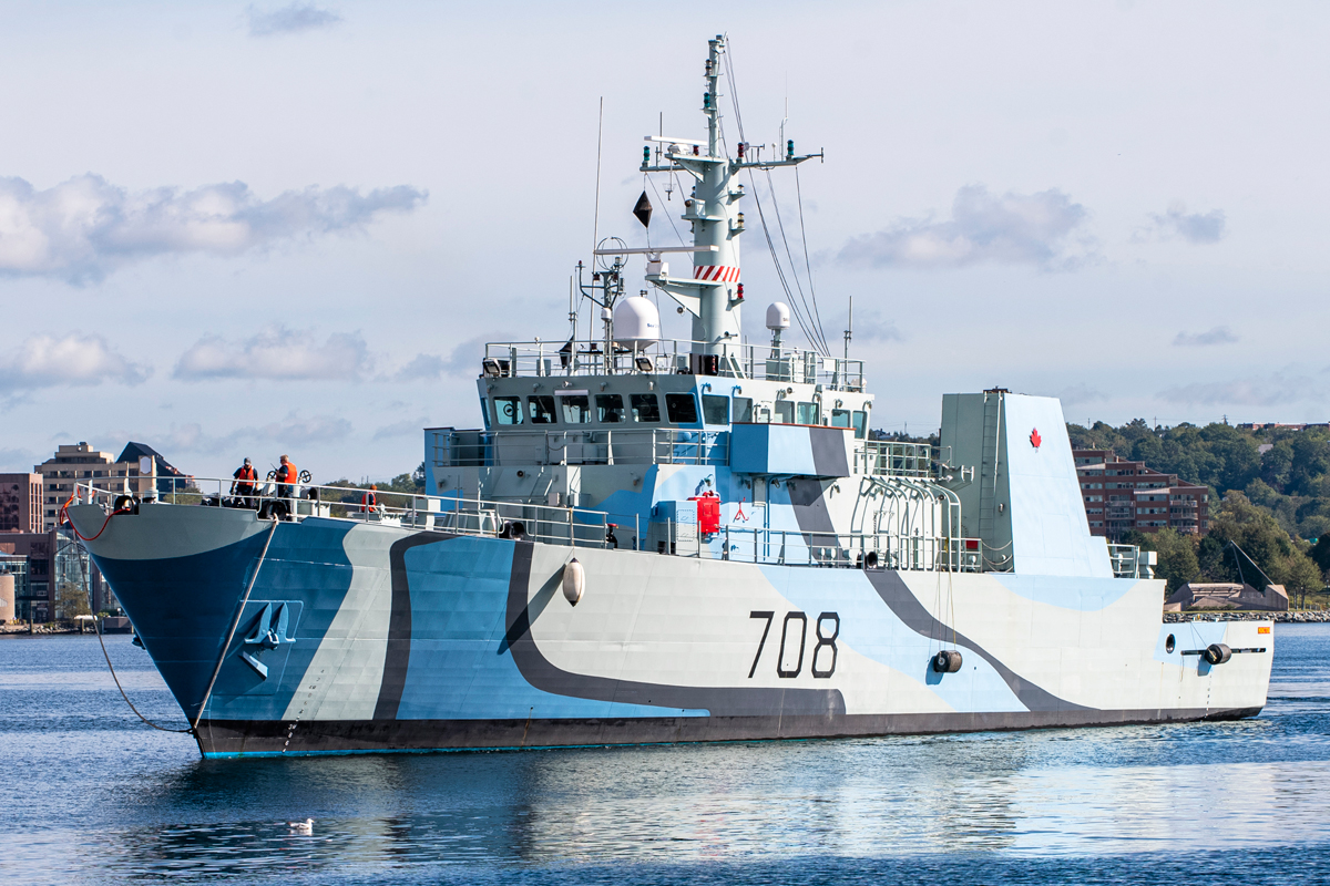 HMCS Moncton returns to its homeport of Halifax after a refit that includes a Second World War Admiralty commemorative paint scheme to honour the 75th Anniversary of the end of the Battle of the Atlantic. The pattern is a form of ship camouflage from the Second World War era. Photo by Mona Ghiz, MARLANT PA