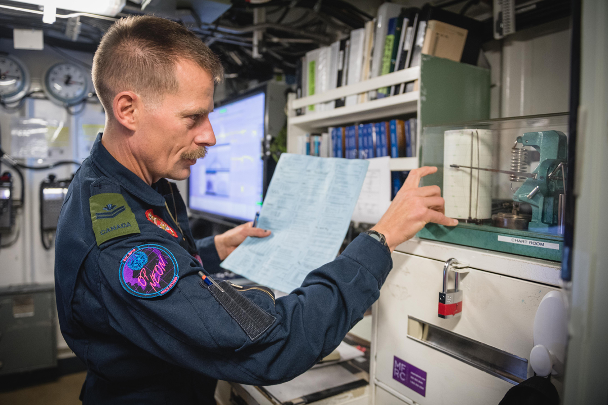 Meteorologist MCpl Dan Jacklin monitors special equipment to help him prepare a weather forecast on board HMCS Ottawa. Photo by Leading Seaman Victoria Ioganov, MARPAC Imaging Services