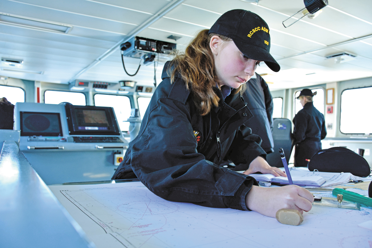 Cadet Hannah Tiemer from 100 RCSCC in Duncan charts a course aboard PCT Raven during the biannual Cadet Seamanship Deployments. Photo by Capt Jordan Holmes