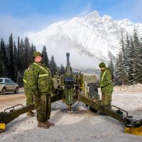Master Bombardier Ryan Houston from 1st Regiment, Royal Canadian Horse Artillery, awaits the loading order from the Troop Commander during the confirmation shout at the start of Operation Palaci at Rogers Pass, B.C. on Nov. 22. Photo by MCpl PJ Létourneau, Canadian Forces Combat Camera