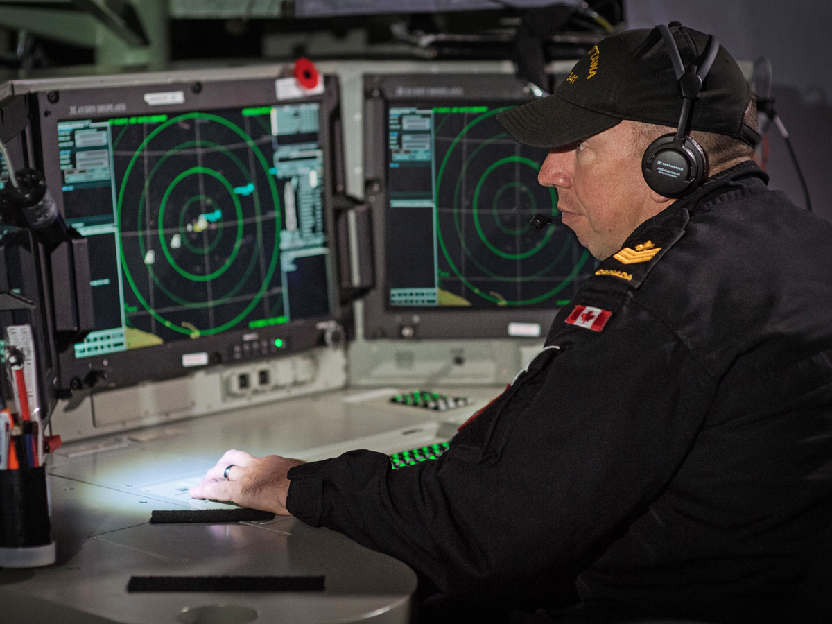 PO2 Sebastien St-Pierre monitors the Senior Sonar Operator Console aboard HMCS Ottawa. Photo by LS Victoria Ioganov, MARPAC Imaging Services