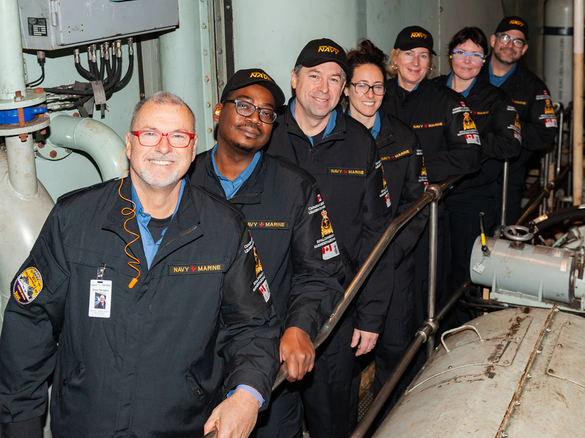 Leaders at sea – left to right: Dave Doroghy, Chris Scipio, Del Elgersman, Andrée St-Germain, Robin Kerbel, Lucy Sager and Kent Klaufield in the ship's engine room for a tour.