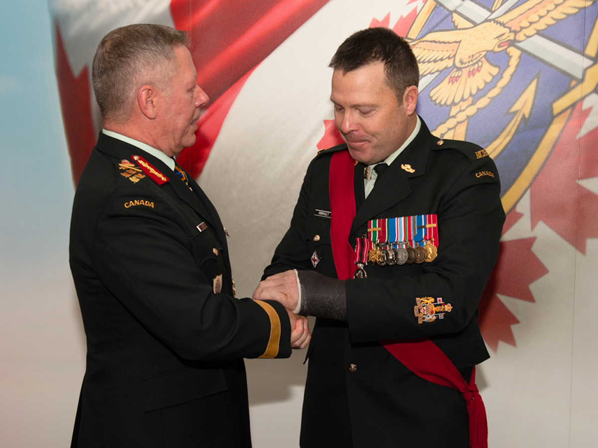 Chief of Defence Staff, Gen Jonathan Vance presents CWO (Retired) Brad Amirault with a Sacrifice Medal at Juno Tower in Halifax on Nov. 23. Photo credit: Sgt Chelsea Hutson
