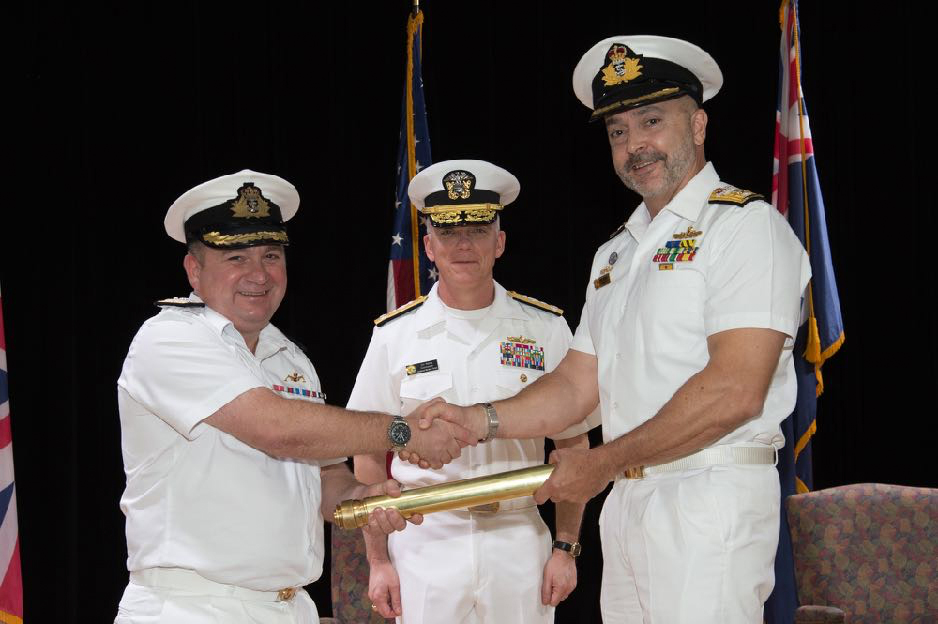 Commodore Ed Ahlgren, Royal Navy (Left) relinquishes command of Combined Task Force 150 to Commodore Ray Leggatt, Royal Australian Navy (right) during  a ceremony at Combined Maritime Forces Headquarters in Manama, Bahrain. The change of command was presided over by Commander Combined Maritime Forces Vice Admiral James Malloy (centre).