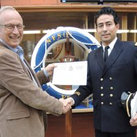 Captain (N) (Ret'd) Kevin Greenwood, Naval Instructor at Naval Training Development Centre (Pacific) presents Tunisian naval officer Lt(N) Khayri Bouzaiene with his Command Development Course certificate at the Collier Building at Work Point. Photo by Peter Mallett, Lookout Newspaper