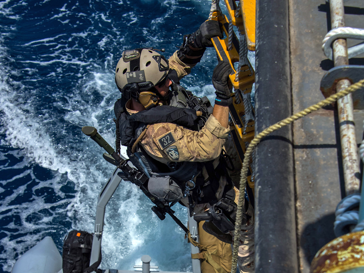 HMCS Regina's Naval Tactical Operations Group prepares to board a Dhow during Operation Artemis in the Pacific Ocean on April 18. Photo by Corporal Stuart Evans, Borden Imaging Services