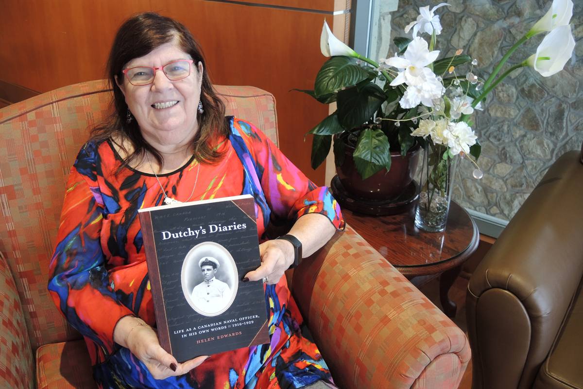 Author Helen Edwards poses with a copy of her book Dutchy's Diaries. The book focuses on the life and times of her father-in-law Commodore John Crispo Inglis Edwards of the Royal Canadian Navy and his travels from 1916 to 1929. Edwards will hold her book launch at the Wardroom on Feb. 18.