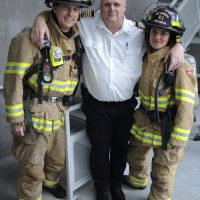 Members of CFB Esquimalt Fire and Rescue's Climb the Wall team, Alexandria Marshall and Mike Gordon are joined by Fire Chief Geordie Douglas. Douglas stopped by to show his support while the pair were practicing for their upcoming competition. The two are part of a five-person team who will be among 200 firefighters participating in a fundraiser for the Lung Association at the Sheraton Vancouver Wall Centre. Photo by Peter Mallett, Lookout