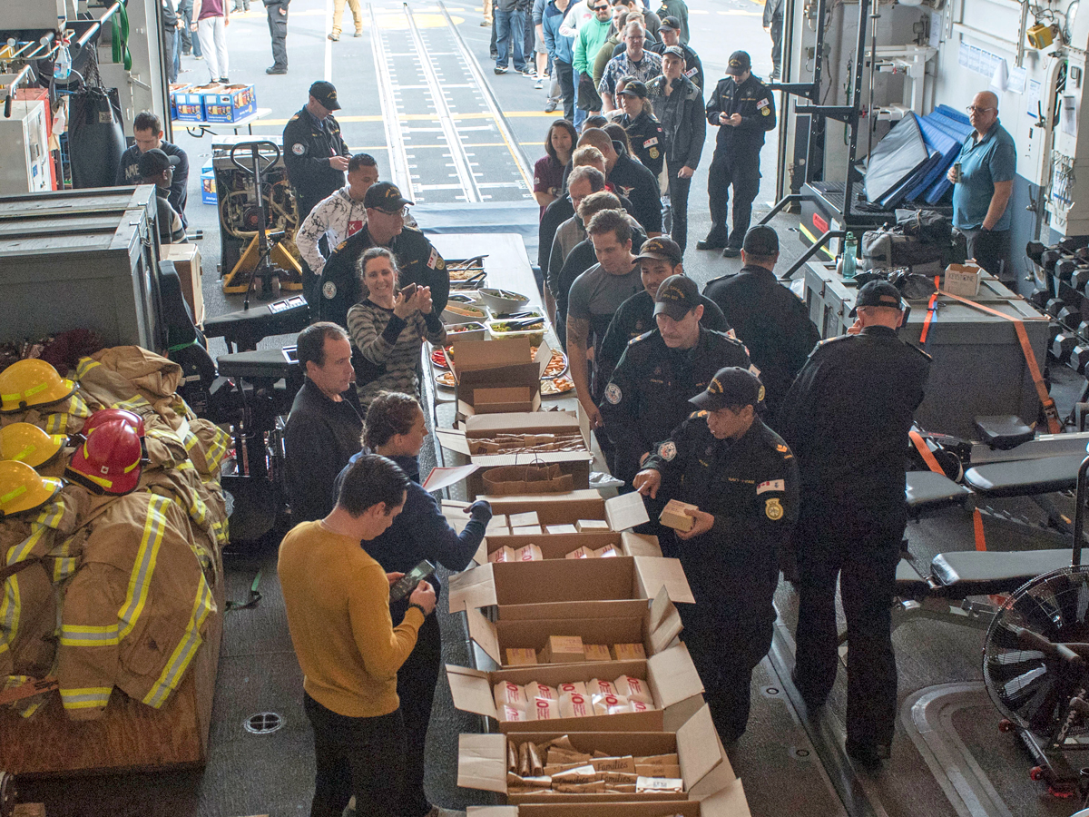 HMCS Calgary crewmembers line up to enjoy some McDonalds food provided by Westshore McDonalds while the ship was alongside F jetty in Colwood on April 30. Photos by Corporal Jay Naples, MARPAC Imaging Services