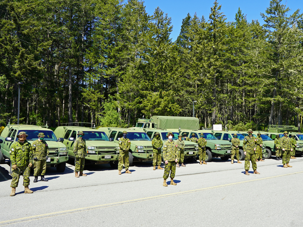 A platoon from Land Task Force Vancouver Island's Domestic Response Company assemble at Canadian Forces Ammunition Depot Rocky Point before returning to base May 6. Photo by Capt Jeff Manney, LCC D/PAO