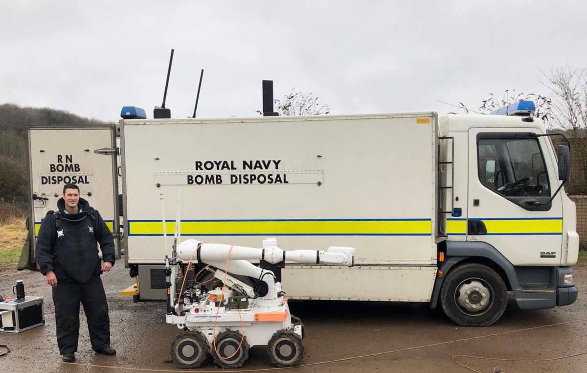 Lt(N) Kevin Okihiro with a bomb disposal robot.