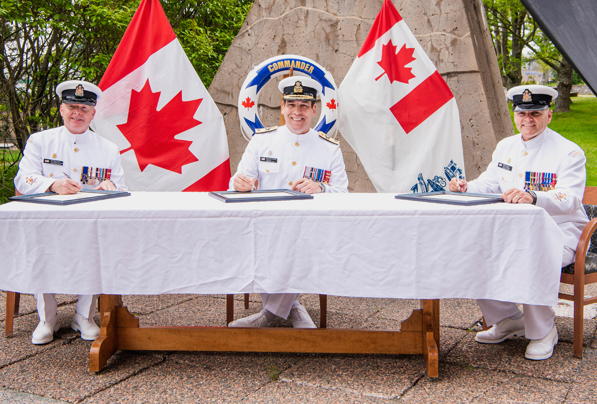 Commodore Richard Feltham, Commander Canadian Fleet Atlantic, presides over the Fleet Chief Change of Appointment ceremony on June 5. From left, outgoing Fleet Chief CPO1 Tom Lizotte, Cmdre Feltham, and incoming Chief CPO1 Darcy Burd. Photo by Mona Ghiz, MARLANT PA