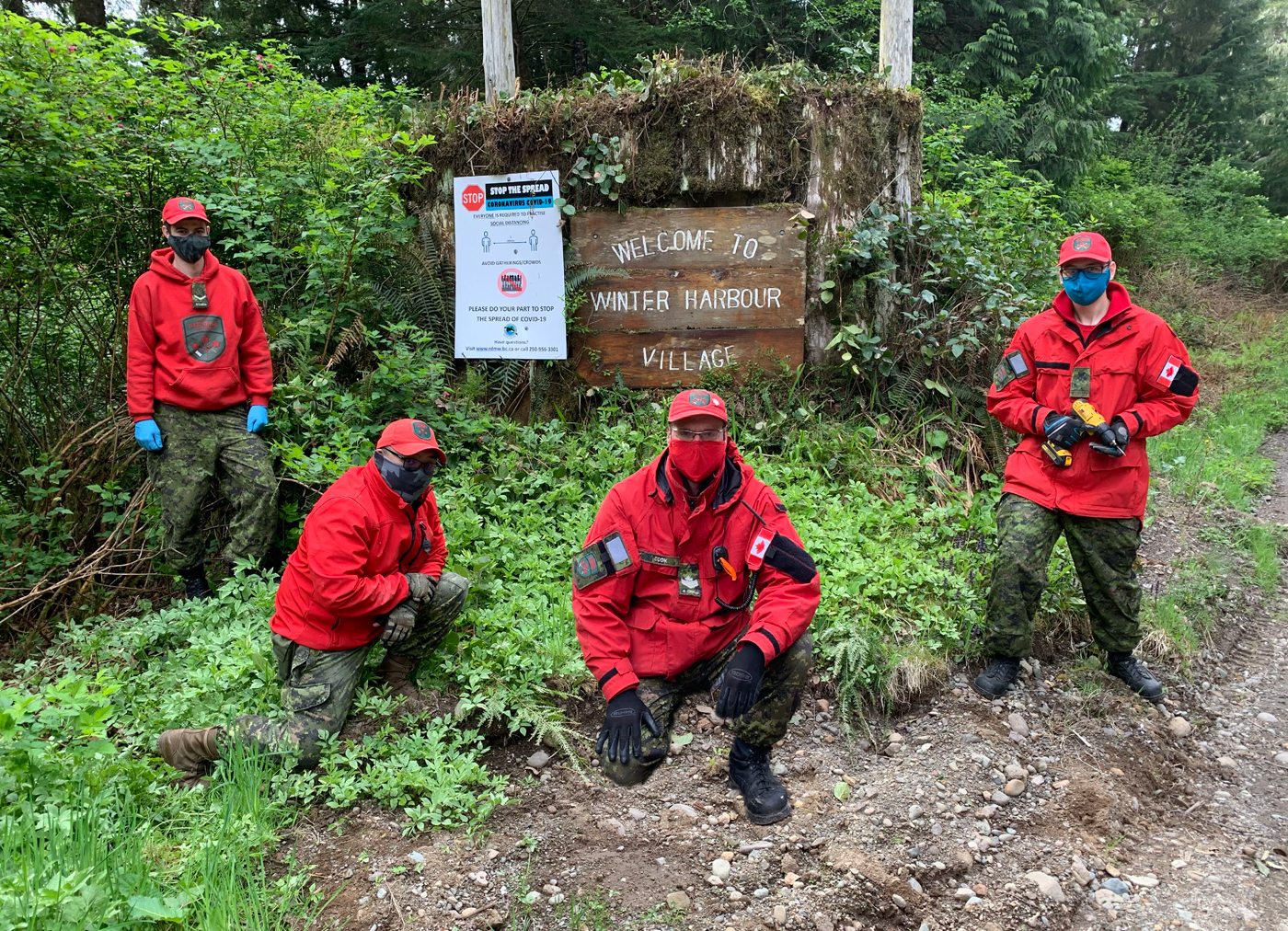 Members of the Port Hardy Canadian Ranger Patrol install signage in Winter Harbour on May 9.