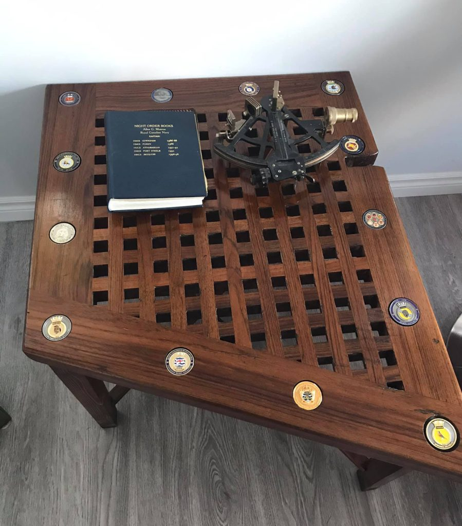 This duckboard table, featuring naval challenge coins laid into the wood, was built for Cdr (Retired) Allen Munroe.