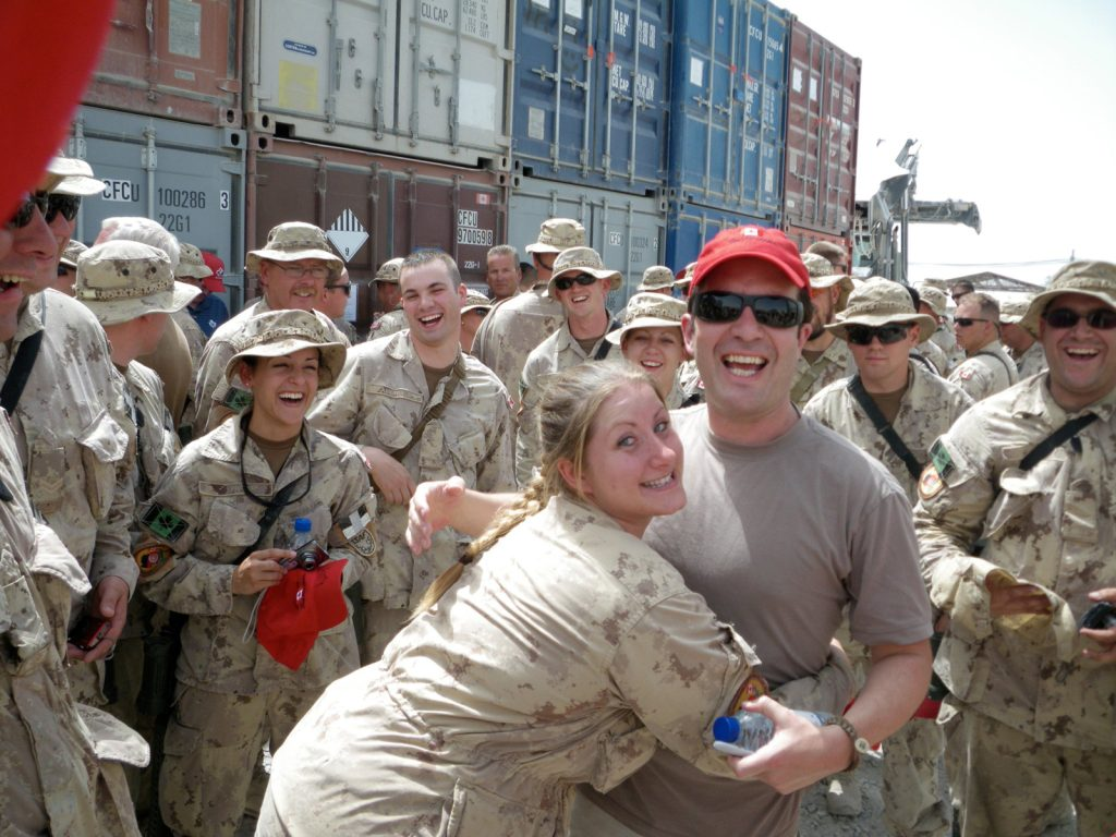 Sgt Allison Geddes hugs TV personality Rick Mercer in Afghanistan where she was part of the Mission Closure Unit. Photo submitted
