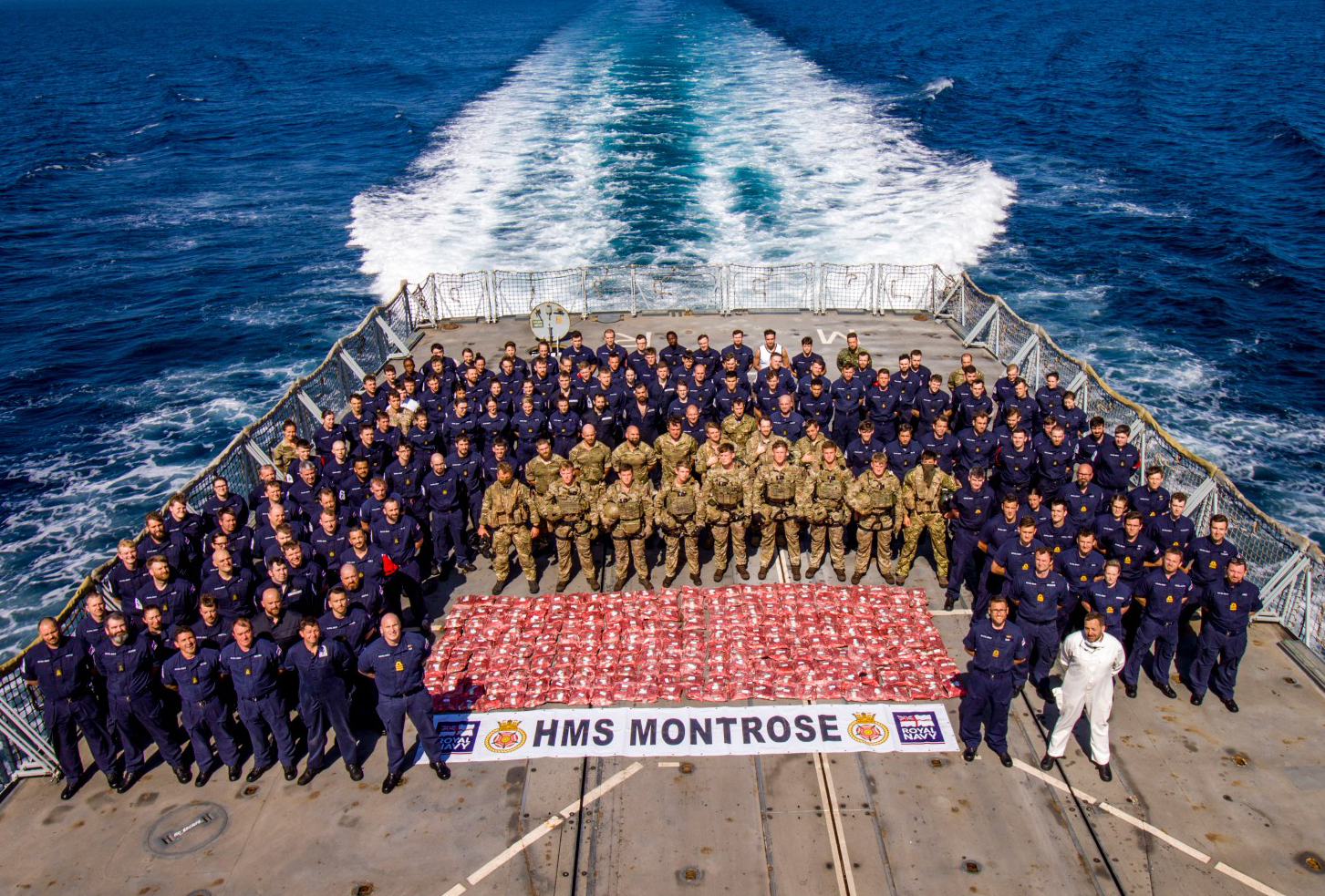 The Crew of HMS Montrose on the flight deck with their 2.7 tonne capture on Feb. 6, 2021.