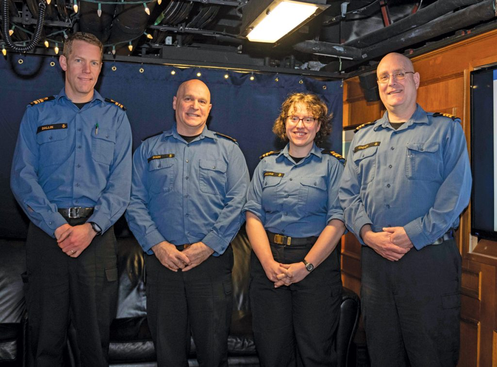Lieutenant Commander David Dallin (left), Chief Petty Officer Carl Dixon (centre left), Lieutenant(N) Blythe McWilliam, the new Command Cultural Advisor, and Cdr Landon Creasy (right) at the Command Culture Advisor Townhall to brief new members of the ship's company. Photo by S1 Lisa K. Wallace, Canadian Armed Forces Photo