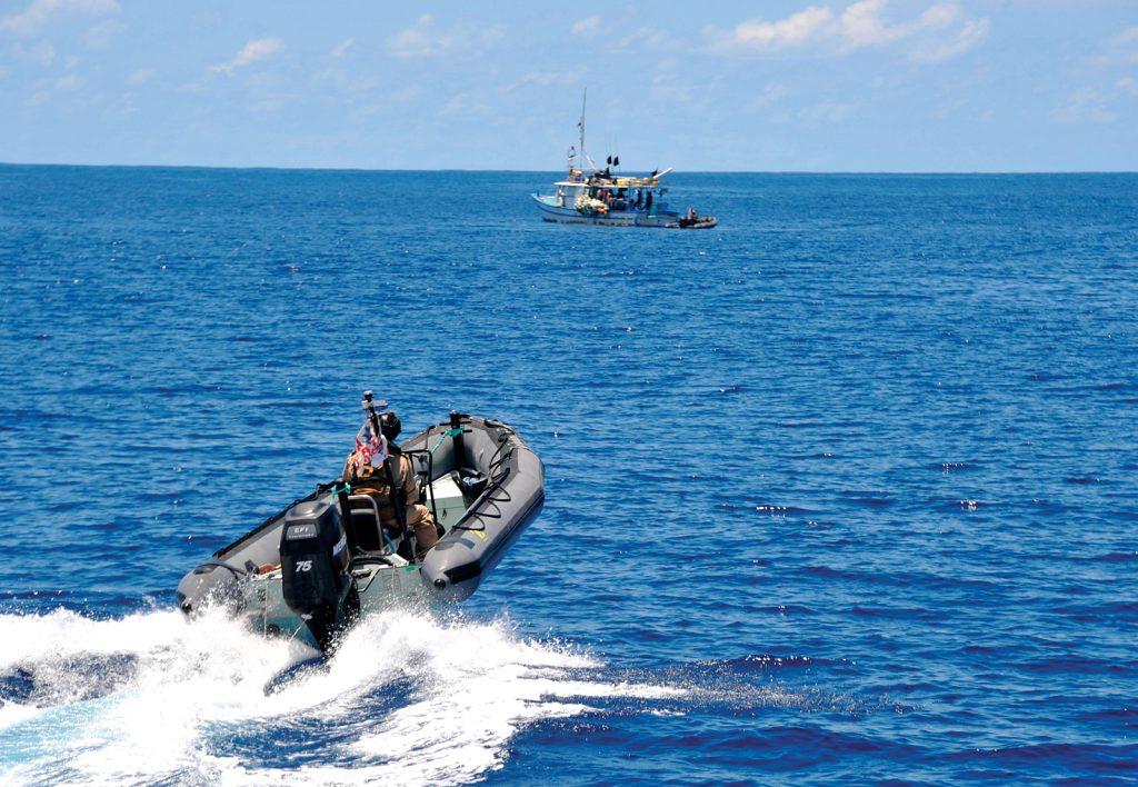 HMCS Saskatoon and the U.S. Coast Guard Southeast Law Enforcement Detachment prepare to intercept a target of interest on March 14.
