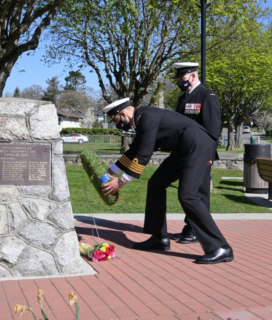 Captain (Navy) Sam Sader, Commander, CFB Esquimalt, and Chief Petty Officer First Class Al Darragh, Base Chief Petty Officer, lay a wreath at the HMCS Esquimalt memorial cairn on Friday to mark the 76th anniversary of the ship's sinking. Photo by CFB Esquimalt Base Public Affairs