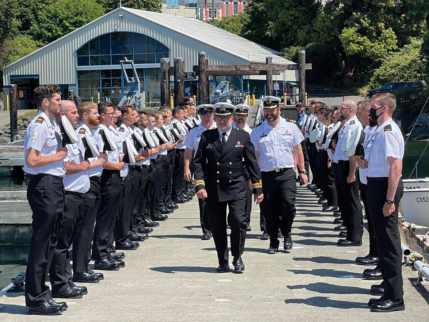 Sailors lined the floats at the Seamanship Training Centre for departing officer LCdr Mike Erwin. Following that, they removed their caps and gave three cheers as the Whaler, staffed by senior staff of Naval Fleet School Pacifc, pulled away to row him ashore.