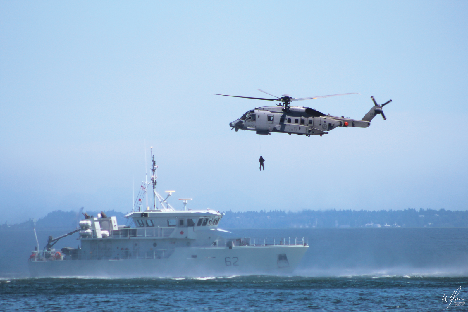 A Cyclone helicopter exercised with the Orcas, doing helo hoists. Photo by SLt Wilson Ho
