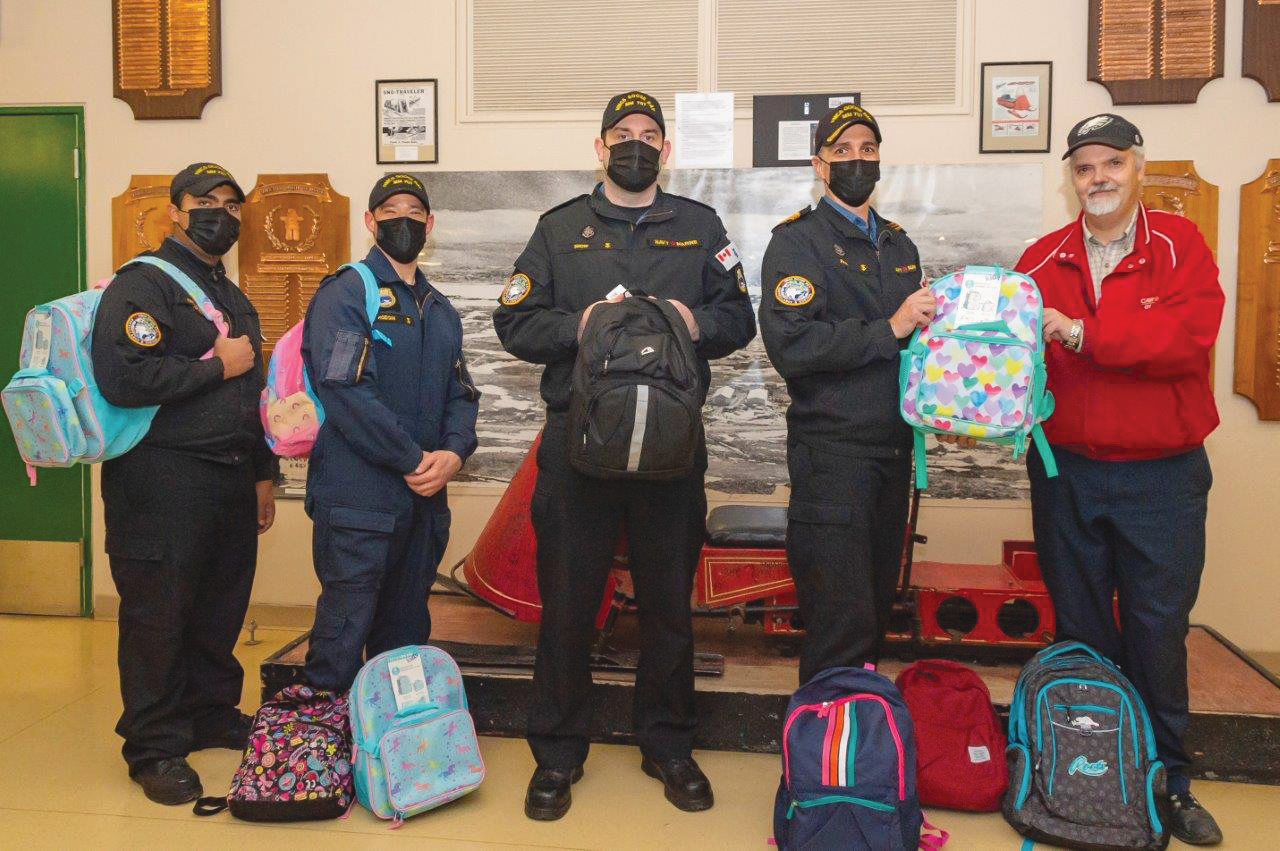 Crewmembers from HMCS Goose Bay with a load of backpacks destined for students in Iqaluit. Goose Bay and HMCS Harry DeWolf sailors both delivered backpacks to Arctic communities courtesy of the Halifax and Region Military Family and Resource Centre.