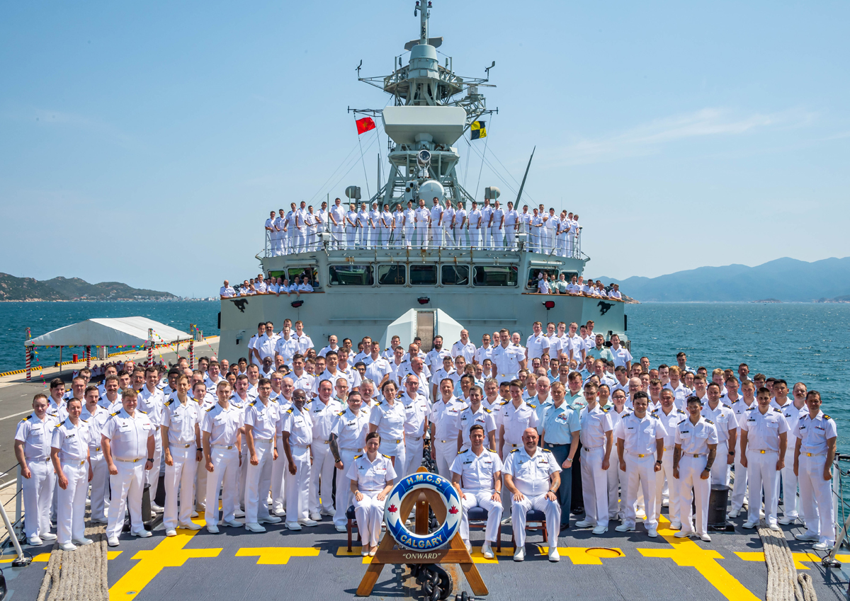 The ship's company stand for a group photo in Cam Ranh Bay, Vietnam, on March 30 while the ship was deployed on Operations Projection and Artemis.