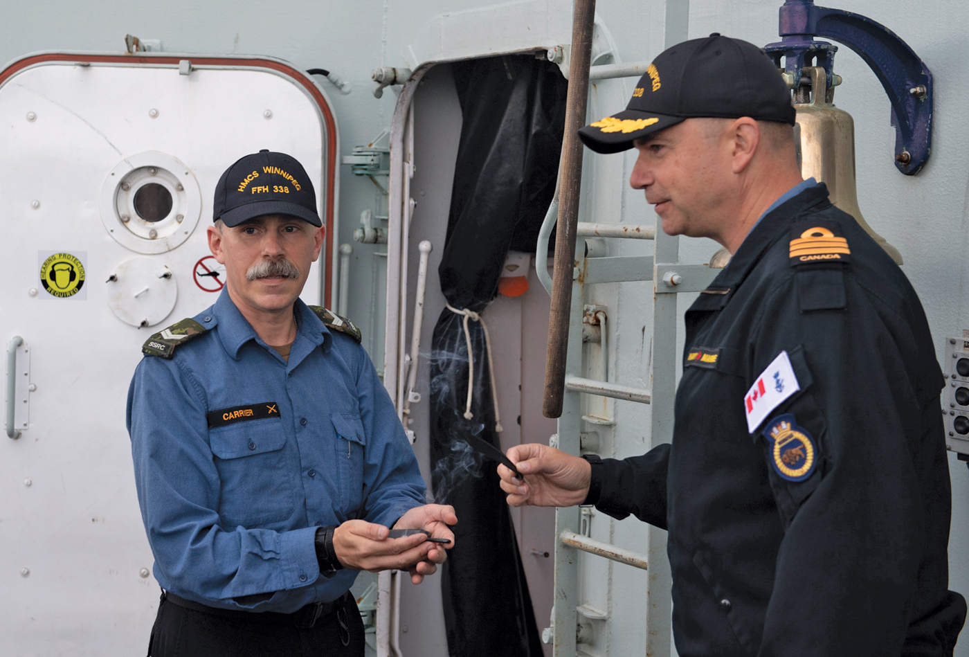 Cdr Doug Layton, Winnipeg's Commanding Officer, took part in a smudging ceremony performed by Cpl Terrance Carrier (left).