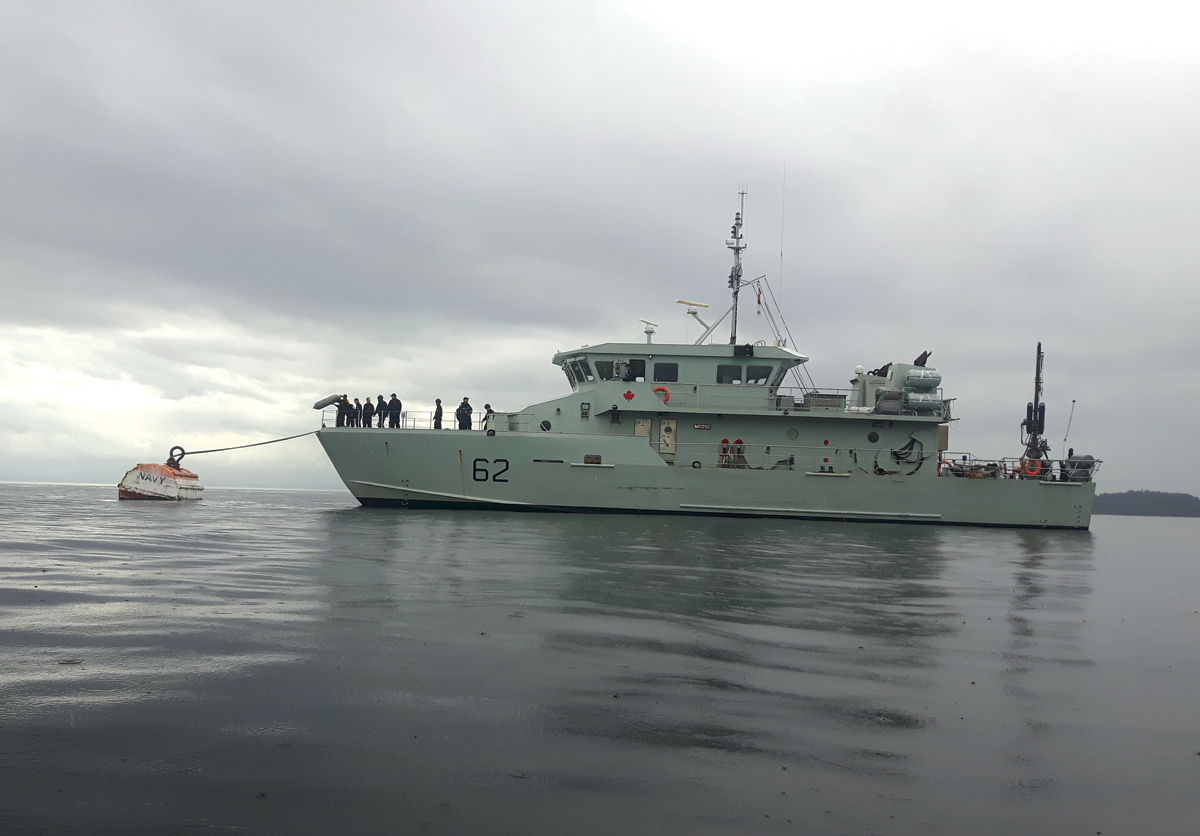 Moose 62 is secured to a mooring buoy as part of a unique training opportunity. Photo by SLt Wilson Ho
