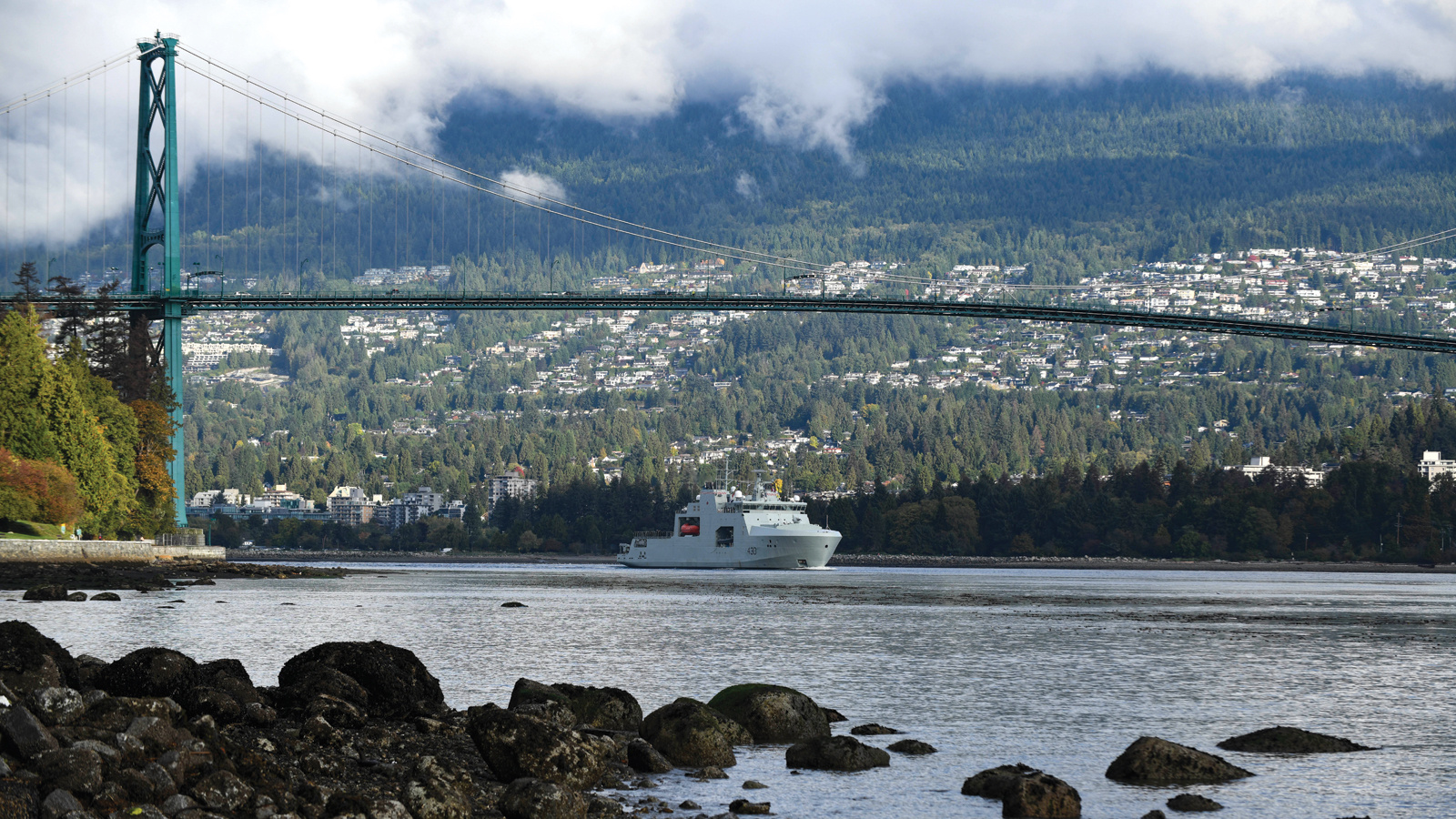 HMCS Harry DeWolf  traverses under the Lions Gate Bridge in Vancouver, British Columbia for the first time. Photo by MCpl Nathan Spence, MARPAC Imaging Services